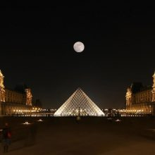 Image: The moon above the Louvre Pyramide
