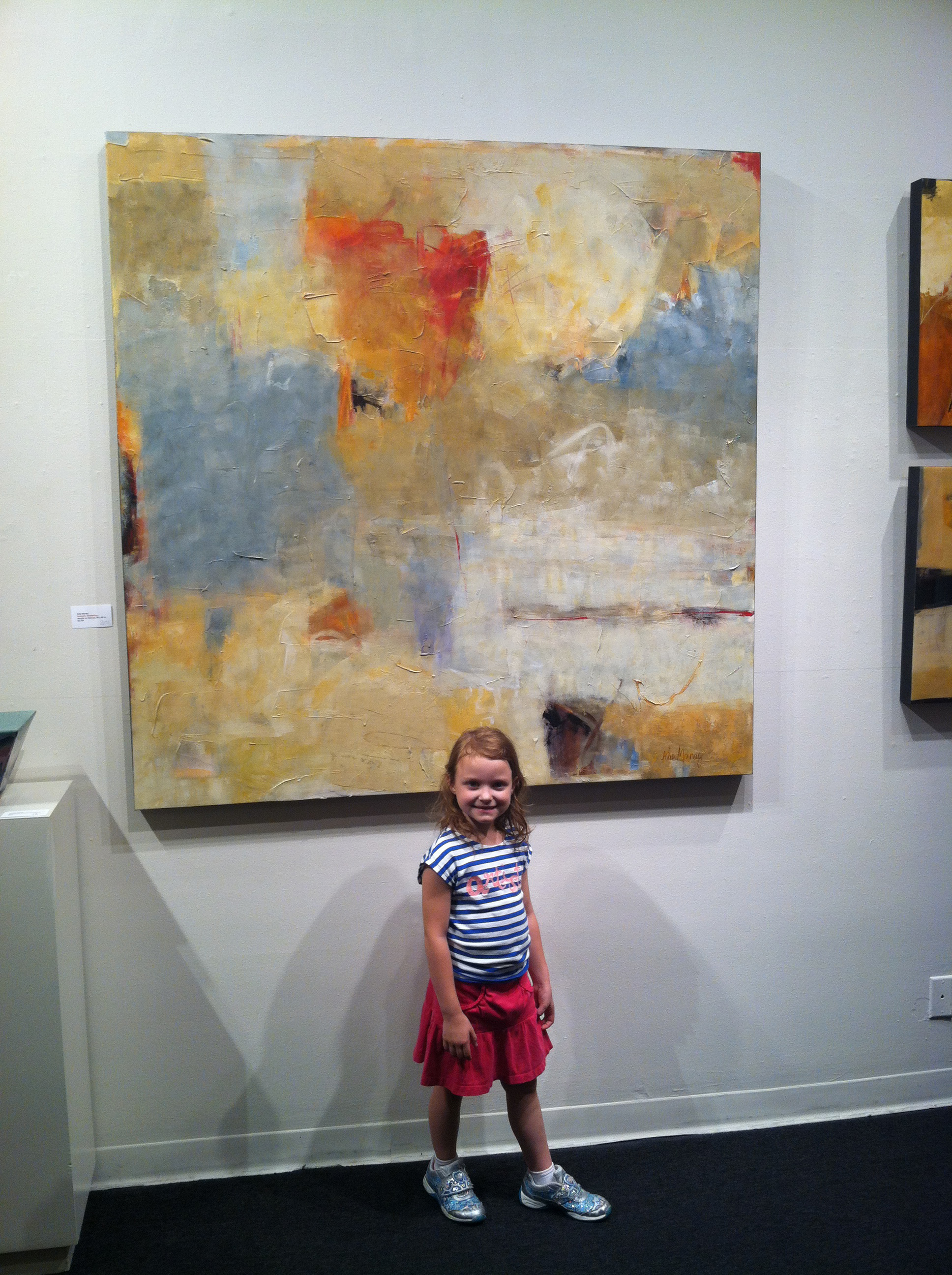 Annie with a Painting by Edie Maney at The Arts Company