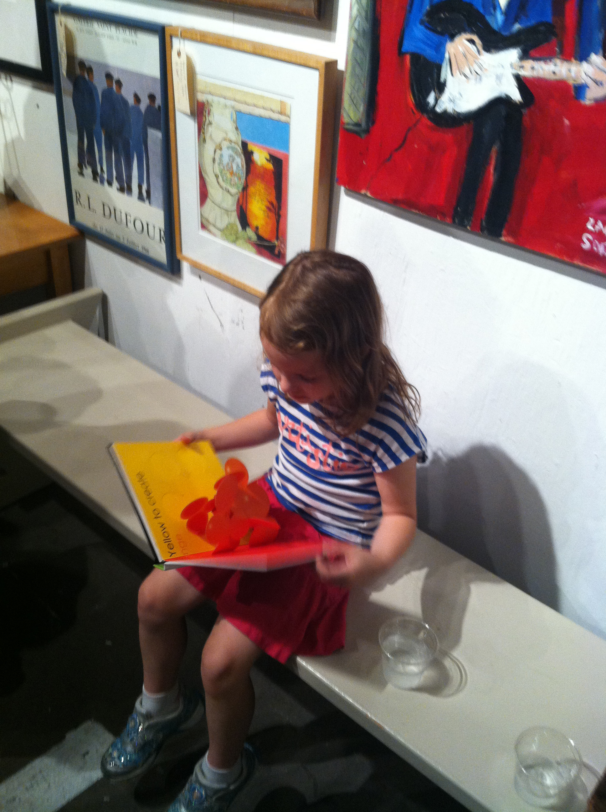 Annie Reading Pop-up Books at The Arts Company