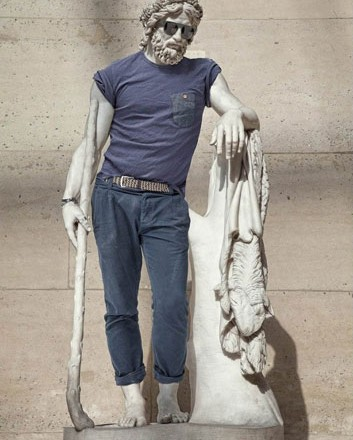Image: sculpture from the Louvre with modern hipster clothing (2013): skinny jeans, a fitted t-shirt, and Ray-Ban sunglasses