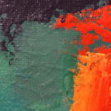 Green, purple, and orange paint smeared with knife