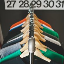Photo of clothes on a rack, by Jeff Sheldon (Ugmunk) via Unsplash