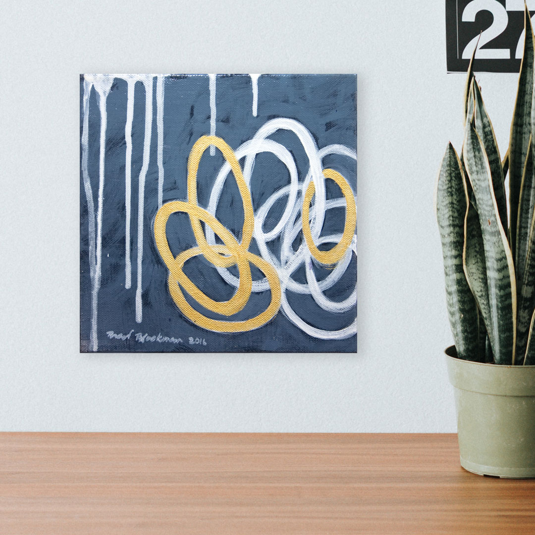 Why make art? It keeps us connected. Photo: Abstract painting of gold and white interconnecting loops, showing how everything is connected.